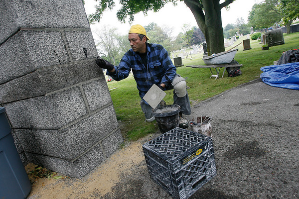 Manchester: Jim DiCenso repairs the mortar joints on the Crowell Chapel in Rosedale Cemetery. He and Dominic Frederico (not shown) have been working on the building for a month and expect to complete the project in a couple weeks. Photo by Kate Glass/Gloucester Daily Times Wednesday, July 1, 2009
