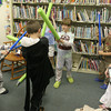 Logan Carroll, 8, and Kai Carroll, 5, duel with their lightsabers during the Star Wars Party at the TOHP Burnham Library while, from left to right, Ryan Andrews, 5, Ben Soulard, 8, Eddie Mulry, 5, and Libby Mulry, 3 all watch from the sidelines. Photo by Maria Uminski/ Gloucester Daily Times