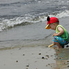 Gloucester: Brendan Sheehan, 2, of Gloucester digs wholes in the sand that were quickly filed by the tide while playing at Niles Beach Sunday afternoon. Mary Muckenhoupt/Gloucester Daily Times
