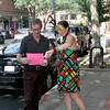 Gloucester: Lara Jardullo gives a flyer to Rory O'Connor on Main Street, advertising a Reagge Boatcruise with Seven Seas Wharf for Saturday August 15th. <br /> Silvie Lockerova/Gloucester Daily Times