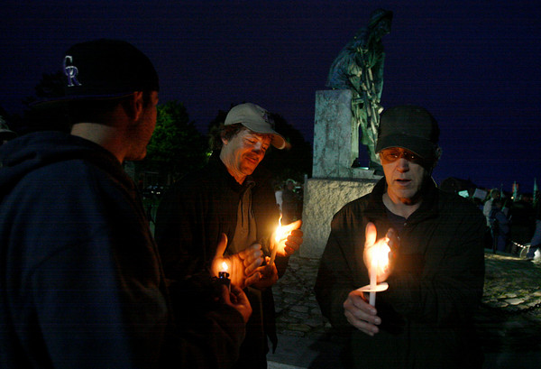 Gloucester: Scott Babcock, left, Barry Klapp, center, both of Point Judith, R.I., and David McCaleb, right, of Gloucester light candles during a vigil at the Fisherman's Memorial to protest fishery enforcement practices. Photo by Kate Glass/Gloucester Daily Times Wednesday, July 8, 2009