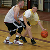 Gloucester: Devin Hemeon, 14, dribbles around Rockport boys basketball coach Tim St. Laurent as the coaches take on the camp all star team during the 25th annual Cape Ann Basketball Clinic put on by Steve Rowell at Gloucester High School Thursday. Mary Muckenhoupt/Gloucester Daily Times