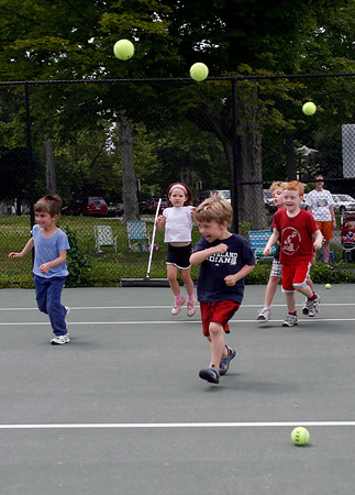 Manchester: Theo Brown, 5, Maggie Ramos, 5, Michael DeOreo, 4, Tristan Nowak, 7, and Christopher Siems, 5, dodge tennis balls as they play Sharks and Minnows at the end of their tennis lesson at the Brook Street Tennis Courts yesterday afternoon. The lessons are offered by the Manchester Parks & Recreation Department. The next session begins July 27th. Photo by Kate Glass/Gloucester Daily Times Tuesday, July 14, 2009