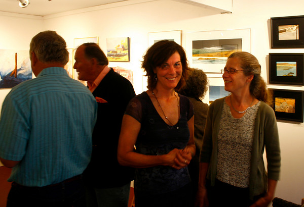 Gloucester: Cynthia Switzer Roth and Anne Marie Crotty, two of the owners of Flatrocks Gallery and bookstore, at their exhibition opening Friday night.<br /> Silvie Lockerova/Gloucester Daily Times