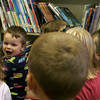 "Henry Thurlow, 3, of Essex reacts to the reading of ""One Duck Stuck"" at the TOHP Burnham Library during the Pajama Party Wednesday night. Maria Uminski/Gloucester Daily Times"