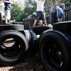Essex: From left: Benny Wassell, 8, Jesse DeWeese-Boyd, 8, Lidia Rudd, 5, and Jude Wassell, 4, climb on the tires at Essex Elementary School while hunting for crystals that give them super powers. Photo by Kate Glass/Gloucester Daily Times Wednesday, July 22, 2009