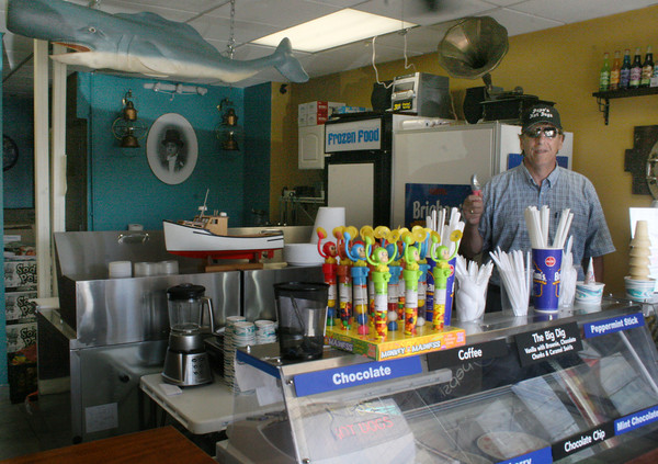 Gloucester: Ed Williams, one of the owners, behind the counter of his store, Popos, on Rogers street. Popos opened this summer on July 1st in Gloucester and also has nine other locations. Popos was nominated as the best Olde Fashioned Gourmet Hotdog in Massachusetts by AOL Cities Best. <br /> Silvie Lockerova/Gloucester Daily Times