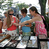 Gloucester: Alexandra Barret, 16, of Rockport shows Beccy Knowles and her sister Brooks, 13, right, some new rings she purchased from the Village Silversmith tent on Main Street during Gloucester Sidewalk Days Thursday afternoon. Gloucester Sidewlak Days are going on today and tomorrow offering food, children's game and lots of shopping. Mary Muckenhoupt/Gloucester Daily Times