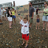 Gloucester: Nathan Master, 5, holds a sign up for his grandma who was due to arrive on Pavilion Beach in an outrigger canoe after competing in Balckburn ChallengeSaturday morning.  The rowing race is a 20-plus mile circumnavigation around points of Cape Ann that begins at the railroad bridge off the Cape Ann Marina and finishes at Pavilion Beach. Photo by Mary Muckenhoupt/Gloucester Daily Times