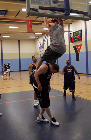 Gloucester: Aldos Fitness' Chris Timson dunks over Harbor House's Jake Baird as they play in the Cape Ann YMCA's 18-plus men's basketball league last night. Photo by Kate Glass/Gloucester Daily Times Monday, July 27, 2009