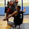 Gloucester: Aldos Fitness' John Pratt knocks Harbor House's Mike Oliver down and is called for a technical as they play in the Cape Ann YMCA's 18-plus men's basketball league last night. Photo by Kate Glass/Gloucester Daily Times Monday, July 27, 2009