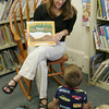 """A Librarian at the TOHP Burnham Essex library listens to a question from Henry Thurlow, 3, of Essex after she read """"One Duck Stuck"""" during the pajama party last night. Maria Uminski/ Gloucester Daily Times"""