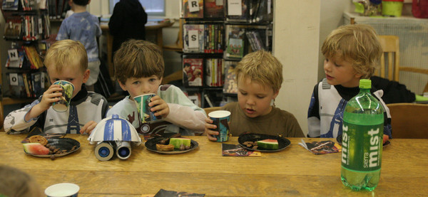 "Ryan Andrews, 5, Kai Carroll, 5, Eddie Mulry, 5, and Luke Smith, 5, enjoy their ""yoda soda"" along with their other Star Wars themed treats during the Star Wars Party at the TOHP Burnham Library in Essex. The kids took part in some relay races before the rain set in. Photo by Maria Uminski/ Gloucester Daily Times"