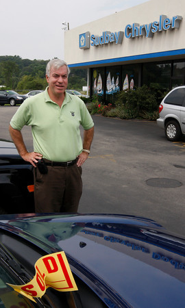 """Gloucester: Don Sudbay Jr. says the """"Cash for Clunkers"""" promotion has been bringing a lot of business to his car dealerships. The government is offering $4,500 for older cars that get poor gas mileage if people trade them in for new cars that get better mileage. Photo by Kate Glass/Gloucester Daily Times Wednesday, July 29, 2009"""