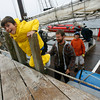 Alex Rodolosi, 10, of Gloucester smiles as he steps off the Spirit of Massachusetts yesterday afternoon after spending five days aboard the ship as part of Gloucester Tall Ship Camp. Rodolosi says he got a little seasick and was looking forward to being back in his own bed. Photo by Kate Glass/Gloucester Daily Times Thursday, July 2, 2009