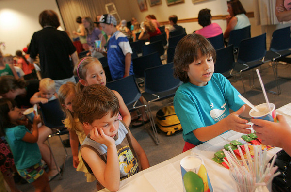Rockport: Julai Moceri waits for her rootbeer float as Dan Williamson is tired of waiting his turn at the summer reading wrap-up party at Rockport Public Library Thursday afternoon. Mary Muckenhoupt/Gloucester Daily Times