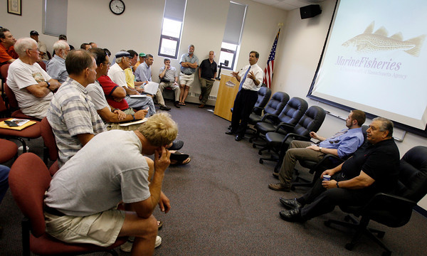 Gloucester: State Sen. Bruce Tarr addresses local clam diggers during a meeting about red tide relief money at the Marine Fisheries Field Station last night. Photo by Kate Glass/Gloucester Daily Times Monday, July 27, 2009