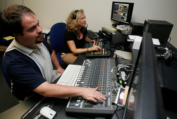 Gloucester: Andrew Love and Lisa Smith of Cape Ann TV demonstrate what happens in the control room of the studio. The station recently won an award for providing community and education programming. Photo by Kate Glass/Gloucester Daily Times Tuesday, July 21, 2009