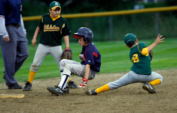 Gloucester: Steven Tetoni steals second base as Sal Costanzo, left, and Eric Chalmers, right, get the ball late during the Gloucester Little League Majors B World Series game between the Athletics and Braves. The Braves won 2-1. Photo by Kate Glass/Gloucester Daily Times Thursday, Julyl 23, 2009