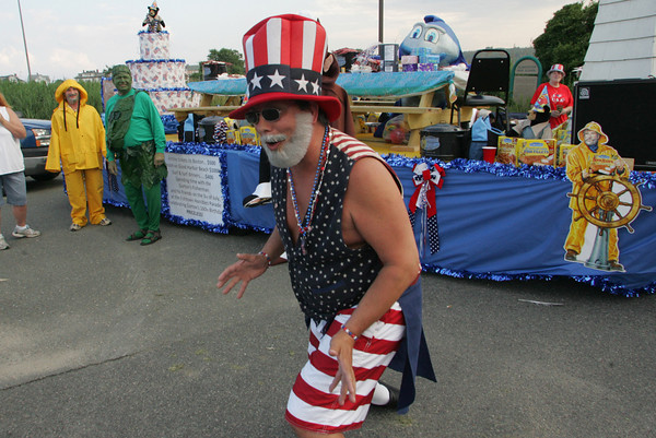 Gloucester: Bill Burnham dances in front of the Gorton's of Gloucester float while getting ready for the Horribles Parade in the parking lot of Gloucester High School Friday evening. Mary Muckenhoupt/Gloucester High School