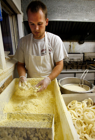 Essex: Chris Whipple of Essex Seafood prepares clams for frying yesterday afternoon. Several local restaurants have removed clams from the menu due to high prices. Photo by Kate Glass/Gloucester Daily Times Wednesday, July 22, 2009