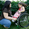 Gloucester: Carolyn Curcuru plays with her daughter, Olivia, 3, while visiting relatives in Gloucester. Olivia, who was born in Gloucester and now lives in Arizona, was paralyzed from the waist down as the result of an accident earlier this year, but refuses to let that slow her down. Photo by Kate Glass/Gloucester Daily Times Monday, July 13, 2009