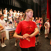 "Manchester: Katerina Eichenberger, playing one of the servants, reheases a scene with the dance chorus for ""My Fair Lady"" at Manchester Memorial Elementary School Thursday evening. Mary Muckenhoupt/Gloucester Daily Times"