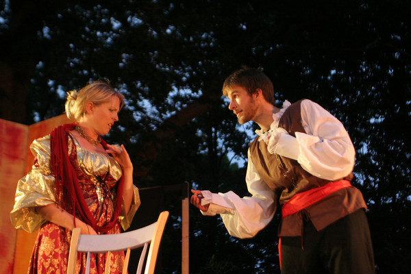 Tom Rash as Petruchio attempts to court Heidi Pulkonen's character Kate during a scene in The Taming of the Shrew. The Shakespearean play, which opens July 31st, will be performed by Theatre in the Pines at Windhover Performing Arts Center. Photo by Maria Uminski/ Gloucester Daily Times