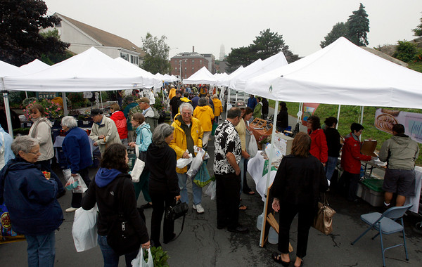 Many people turned out for the opening day of the Cape Ann Farmers' Market yesterday afternoon despite the rainy weather. Photo by Kate Glass/Gloucester Daily Times Thursday, July 2, 2009