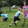 Rockport: Rebecca Dowd gets tagged by Linden Adamson while playing a game of tag at Art Harbor summer camp at Windhover Performing Arts Center Thursday afternoon.  The camp offers drama, dance and visual arts from 9-4, rain or shine and runs July 20-24 and July 27-31. For enrollment information contact Dona Lambert at 978-546-9041. Mary Muckenhoupt/Gloucester Daily Times