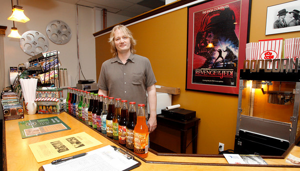 Gloucester: Rob Newton of Cape Ann Community Cinema has set up its permanent home at 21 Main Street in Gloucester. Photo by Kate Glass/Gloucester Daily Times Tuesday, July 7, 2009