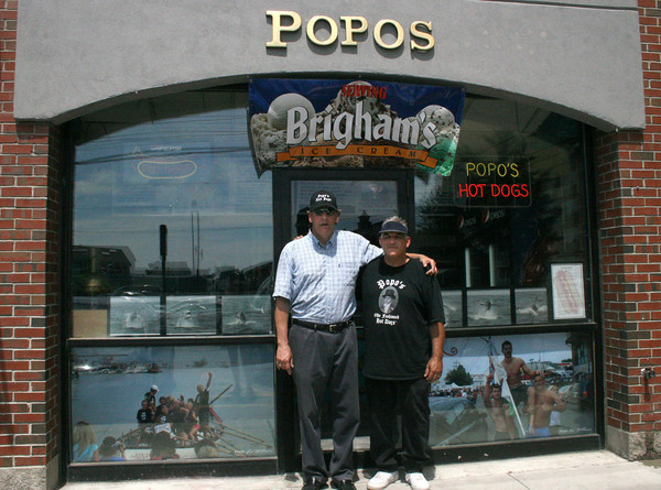 Gloucester: Ed Williams and Mark Scaglione outside of their store, Popos, on Roger street. Popos opened this summer on July 1st in Gloucester and also has nine other locations. Popos was nominated as the best Olde Fashioned Gourmet Hotdog in Massachusetts by AOL Cities Best. <br /> Silvie Lockerova/Gloucester Daily Times
