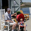 Rockport: Michael Lyons of Peabody pushes his grandson, who is visiting from Seattle, around Bearskin Neck on Monday afternoon. Photo by Maria Uminski/Gloucester Daily Times