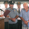 Gloucester: Gloucester Mayor Carolyn Kirk presents a special commendation to Patrolman Mark Foote for helping rescue a boater earlier this week. Standing with Foote is his father, City Councilor Gus Foote. Photo by Kate Glass/Gloucester Daily Times Thursday, July 30, 2009