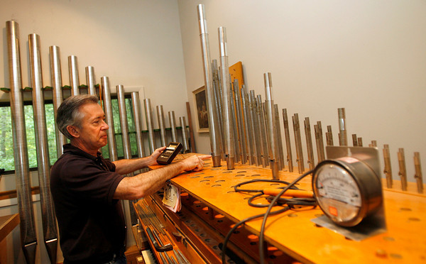 Greg Bover of C.B. Fisk Organbuilders shows how they tune the voices, or pipes, for their organs. The company recently built a 2 million dollar organ for Indiana University's School of Music. Photo by Kate Glass/Gloucester Daily Times Monday, July 27, 2009