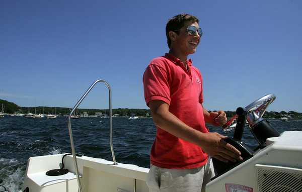 Gloucester: T.J. Greel drives a boat belonging to the Anniquam Yacht Club across the Annisquam River on Saturday afternoon. Mary Muckenhoupt/Gloucester Daily Times