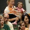 Gloucester: Dawn Sarrouf holds her daughter, Esme Sarrouf, 1, who got excited as screech owl was brought out during the Audubon Ark Birds of Prey program at the Sawyer Free Library yesterday morning. Attendees got to see a screech owl, broadwing hawk, and great horned owl. Photo by Kate Glass/Gloucester Daily Times Monday, July 6, 2009