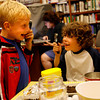 Manchester: Nicholas Talleri, left, and Colin Genta look at each other through magnifying glasses while doing science experiments at the Manchester Public Library yesterday afternoon. The kids were examining dirt samples to look for signs of life. Photo by Kate Glass/Gloucester Daily Times Tuesday, July 21, 2009