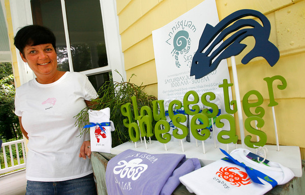 Gloucester: Jill Josephson of Gloucester started her business, Gloucester Oneseas, after she was let go from her position at Gillette. Josephson designs ocean symbols and phrases for shirts using environmentally friendly products. Photo by Kate Glass/Gloucester Daily Times Thursday, July 23, 2009