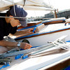 Rockport: Alek Razdan of Rockport prepares his neighbor's boat to be painted off Lumber Wharf on Tuesday afternoon. Razdan says he is taking advantage of the sunny days to get the painting done. Photo by Kate Glass/Gloucester Daily Times Tuesday, July 28, 2009