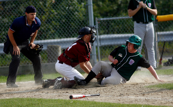 Gloucester: Gloucester catcher Jay Fulmer tags Billerica's Shawn Vereker out at home plate during their Senior Little League game at Nate Ross Field last night. Photo by Kate Glass/Gloucester Daily Times Monday, July 20, 2009