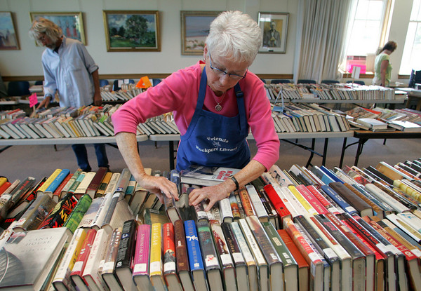 Rockport: Judy Spurr works on arranging books at the Rockport Friends of the Libray Book Sale at Rockport Library Friday afternoon.  The sale will also being going on today from 10 a.m. to 5 p.m. and tomorrow noon to 5 p.m. Mary Muckenhoupt/Gloucester Daily Times