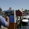 "Anthony Watkins of Maine paints the picturesque scene in Bearkskin Neck yesterday afternoon. Watkins keeps coming back to Rockport because he thinks its a ""beautiful place"". Photo by Maria Uminski/Gloucester Daily Times"
