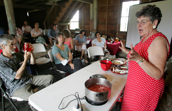 Essex: Caroline Craig gives a lecture and demonstration on cannining and preserving at Cogswell's Grant Saturday.  Fro over twenty years Craig worked for the Little Family who once lived on the property and one summer put up more than eight hundred jars of jams, jellies and preserves.  One thing that shocked those who took the class was how much sugar goes into making jam. Craig demonstrated making strawberry jam and used seven cups of sugar. Mary Muckenhoupt/Gloucester Daily Times
