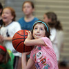 Gloucester: Julia Moceri, 7, carefully aims to ball for the basket at the 25th annual Cape Ann Basketball Clinic put on by Steve Rowell at Gloucester High School Thursday. To the delight of Julia and her friends she made the shot. Mary Muckenhoupt/Gloucester Daily Times