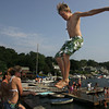 Gloucester: Jonny Good, 12, of Gloucester jumps off the foot bridge in Annisquam on Sunday afternoon.  The bridge was filled with kids and adults who took to the water to cool off. Mary Muckenhoupt/Gloucester Daily
