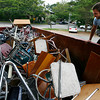 Manchester: Manchester Essex High School custodian Steve Hunt stacks a pile of chairs that will be thrown away as they prepare to move to the new building. Hunt says some items are being recycled or scrapped and good furniture will be sold at a yard sale on July 11th. Photo by Kate Glass/Gloucester Daily Times Wednesday, July 1, 2009