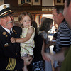 Gloucester: Gloucester Interim Fire Chief Phil Dench holds his granddaughter, Breanna Dench, 3, following the Public Safety Badge Ceremony at City Hall last night. Photo by Kate Glass/Gloucester Daily Times Thursday, July 30, 2009