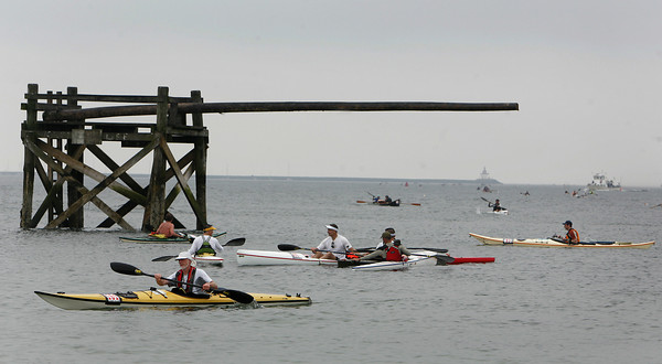 Gloucester: Kayakers arrive at Pavilion Beach Saturday morning after completeing the Balckburn Challenge.  The rowing race is a 20-plus mile circumnavigation around points of Cape Ann that begins at the railroad bridge off the Cape Ann Marina and finishes at Pavilion Beach. Photo by Mary Muckenhoupt/Gloucester Daily Times