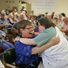 "Gloucester: Nancy Gagne, left, hugs her friend Janice Cook after Cook and Ron Pool performed ""Ally Oop"" at Day by Day adult daycare center in Gloucester Wednesday afternoon. Day by Day held thir Senior Idol contest where people who go to the facilty could perform and get reviewed by judges.  Mary Muckenhoupt/Gloucester Daily Times"
